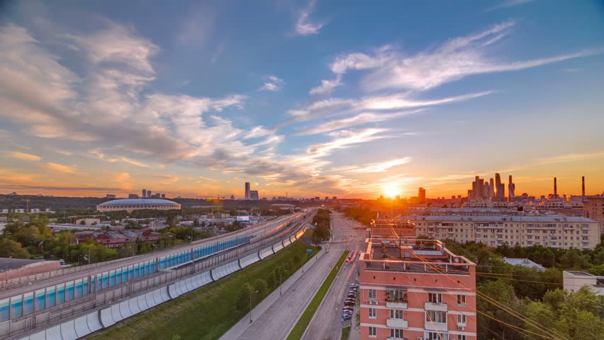 The Third Ring Road traffic at sunset timelapse aerial view from rooftop. Skyscrapers and stadium on background. The Third Ring is Moscow's newest beltway, located between the Garden Ring in the city | Shutterstock HD Video #32334781