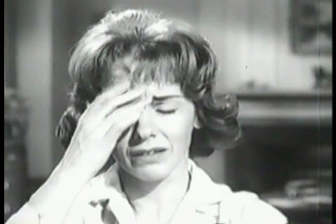 CIRCA 1950s - An irritable mother with a headache takes Anacin and calms down and helps her son, in a television commercial, in the 1950s.