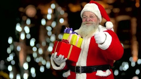 5b21b64c9e41b Santa showing thumb up gesture. Happy Santa Claus with gifts. Best Christmas  present ideas
