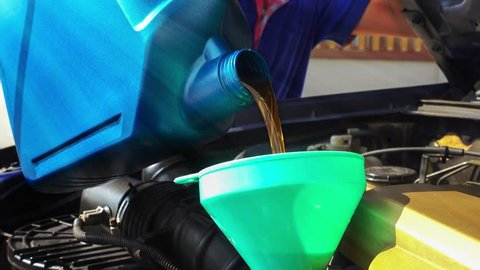 Cinemagraph looping of pouring motor oil in to a engine.