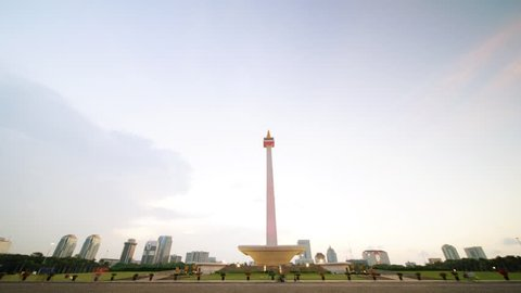 JAKARTA, Indonesia. October 30, 2017: Day to night timelapse of Monas or National Monument with moving clouds at sunset time. A historical landmark placed in Jakarta, Indonesia