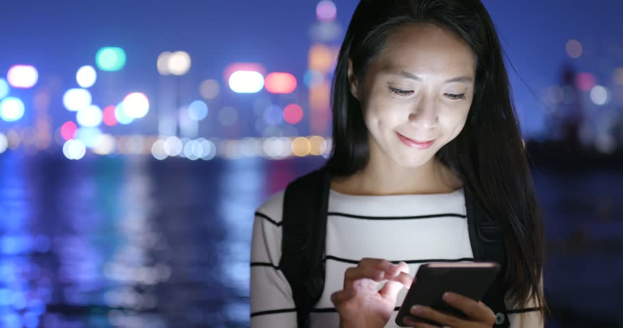 Woman use of cellphone in city at night  | Shutterstock HD Video #32432515