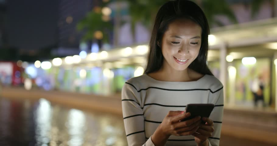 Woman use of smart phone in Hong Kong at night  | Shutterstock HD Video #32432545