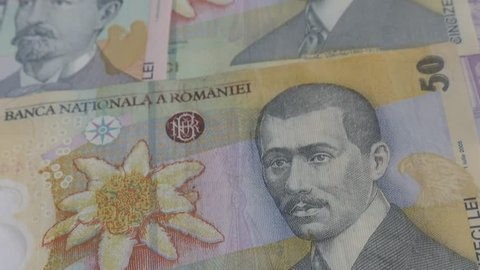 Tilting over Romanian lei national currency banknote 3840X2160p 30fps UltraHD video - Paper money of Romania in a row close-up 4K 2160p UHD footage