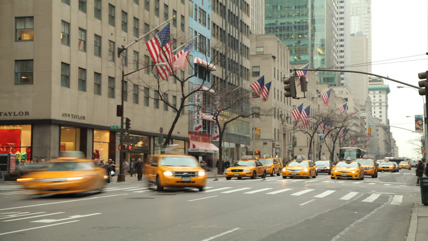 NEW YORK - CIRCA JANUARY 2013: 5th Avenue time lapse day yellow cabs