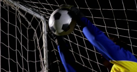 Goalkeeper catching a soccer ball in the playing field 4k