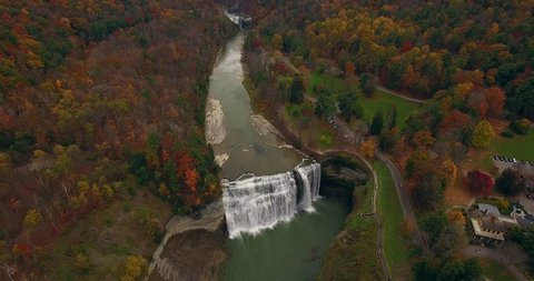 Fall foliage surrounds a waterfall at Letchworth State Park, in upstate New York.