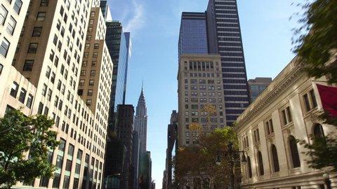 Drone establishing shot of skyscrapers buildings street in NYC New York City Manhattan