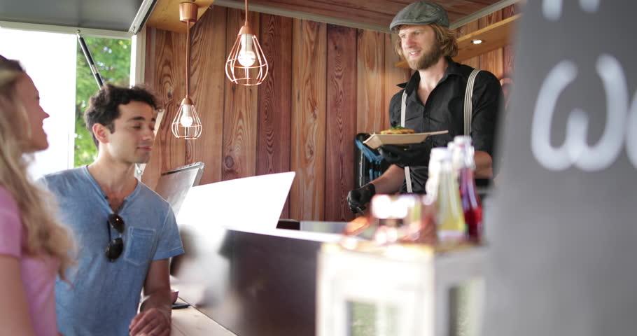 Food Truck owner serving customers | Shutterstock HD Video #32554555