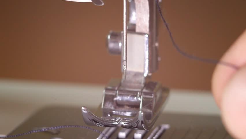 Automatic sewing machine threader   Shutterstock HD Video #32598415