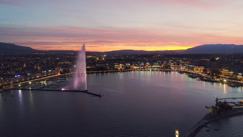 Aerial view of sunset at Geneva Water Fountain (Jet d'Eau) in Geneva Lake, Switzerland.