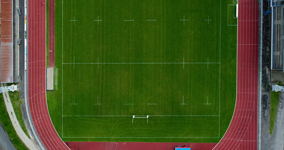 rugby stadium with athletic track in aerial view