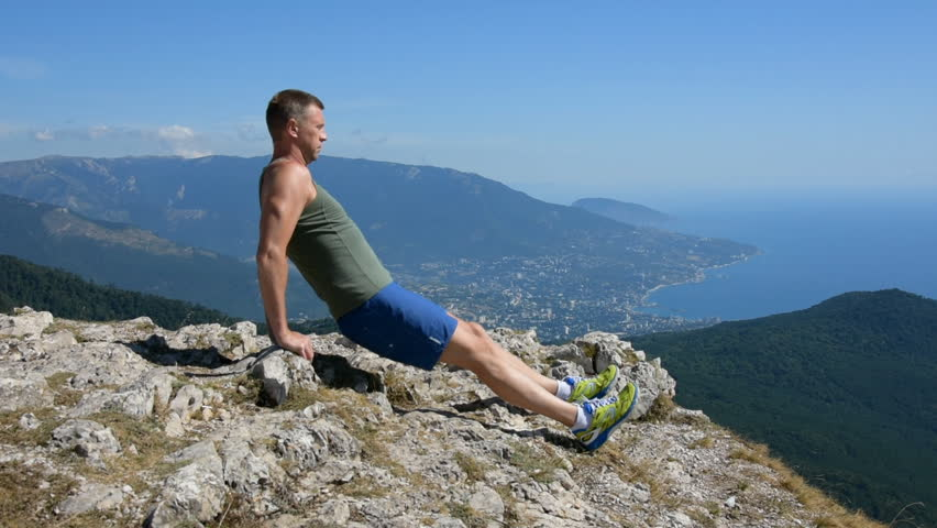 Push ups. Fitness in nature. Adult man and a healthy lifestyle. #32700295
