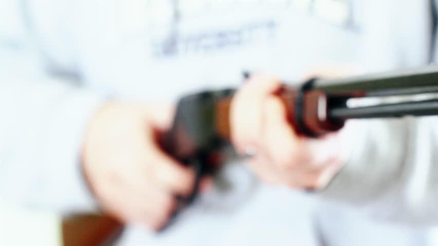 Man holding a rifle | Shutterstock HD Video #3271109