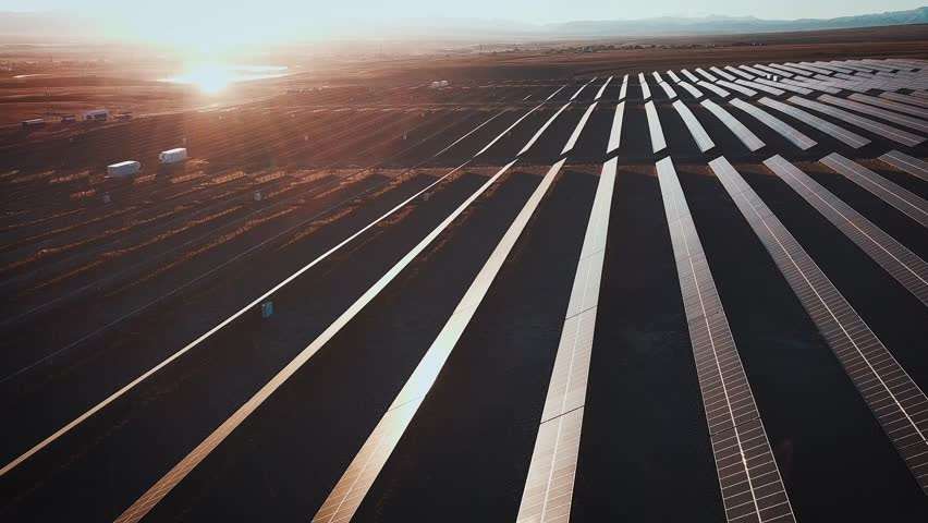 Aerial desert view large industrial Solar Energy Farm producing concentrated solar power. Around the mountain and the sun sets at sunset | Shutterstock HD Video #32711938