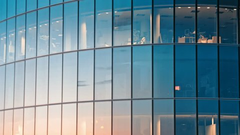 Abstract reflections of tall buildings from glass skyscraper facade