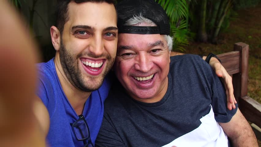 Dad and son taking a selfie | Shutterstock HD Video #32719075