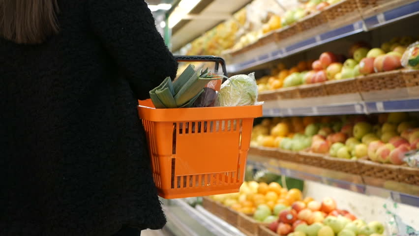 Slow motion of a woman with shopping cart walking alongin the supermarket. Buying fruit | Shutterstock HD Video #32724379