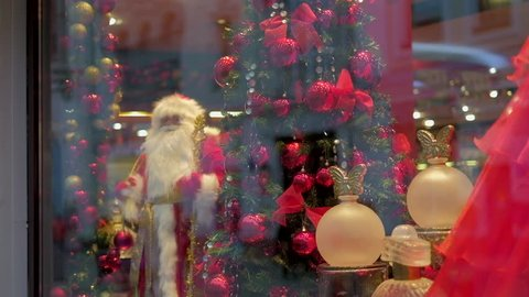 Santa Claus and christmas decorated tree under the window. Gimbal shot