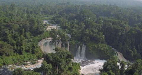 Aerial high view waterfalls of huge river flooding the equatorial deep forest in Africa Gabon 2015