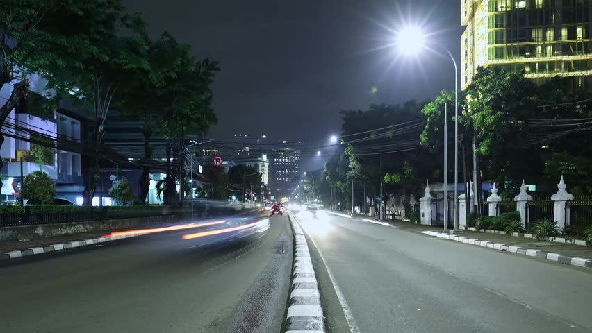 JAKARTA, Indonesia. November 13, 2017: Time lapse footage of traffic at night in Jakarta highway. Shot in 4k resolution | Shutterstock HD Video #32770735