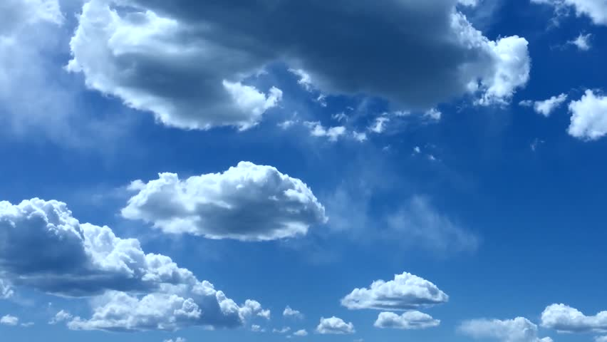 PUFFY CLOUDS, Puffy fluffy white clouds blue sky time lapse motion background. Bright blue sky puffy fluffy white cloud cloudscape cloudy heaven. Puffy fluffy white cloud blue sky background. FHD. | Shutterstock HD Video #32781955