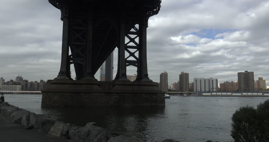 A ferry travels the East River, past the Manhattan Bridge, in New York City. | Shutterstock HD Video #32789455
