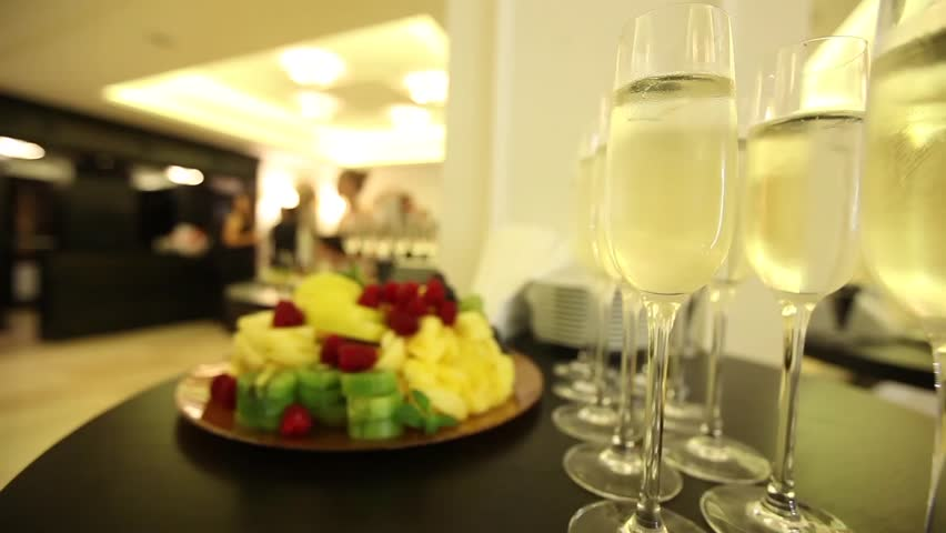 A Glass Of Champagne On A Buffet Table In The Lobby Of A Restaurant Or Hotel