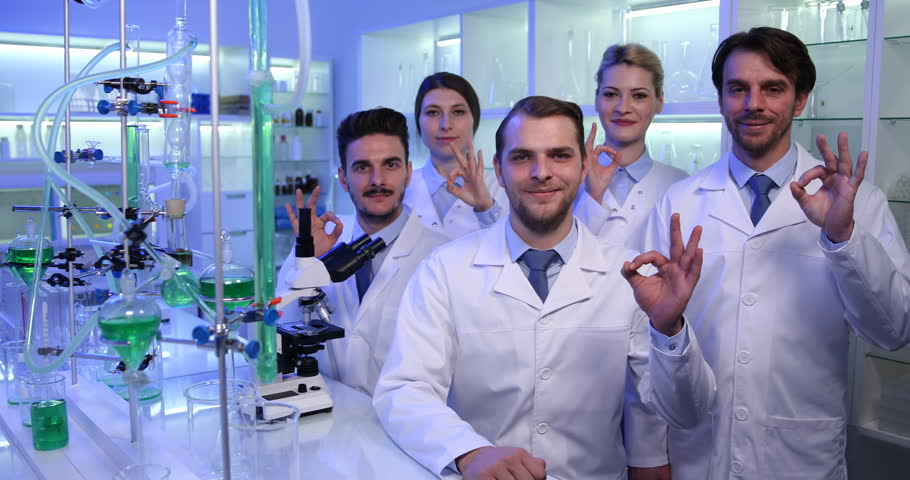 Researchers Group Showing Ok Sign Success Experiments Laboratory Presentation