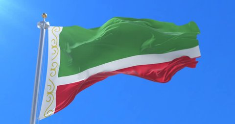 Flag of the Chechen Republic waving at wind with blue sky
