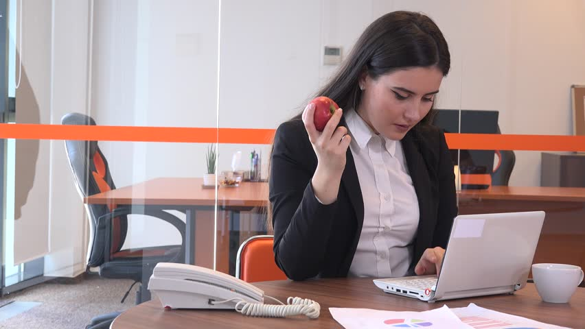 people bored at work. successful elegant young business people indoors workplace laptop work eat fruit - 4k stock video clip bored at