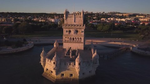 The Belem Tower at sunset.  4k aerial drone footage of a medieval fortress that defended the city of Lisbon (Lisboa) Portugal.