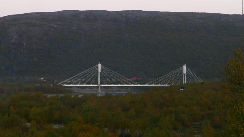 White bridge, Zoom out time lapse of the border bridge between norway and utsjoki town, on a sunny autumn day, Lapland, Lappi, Finland