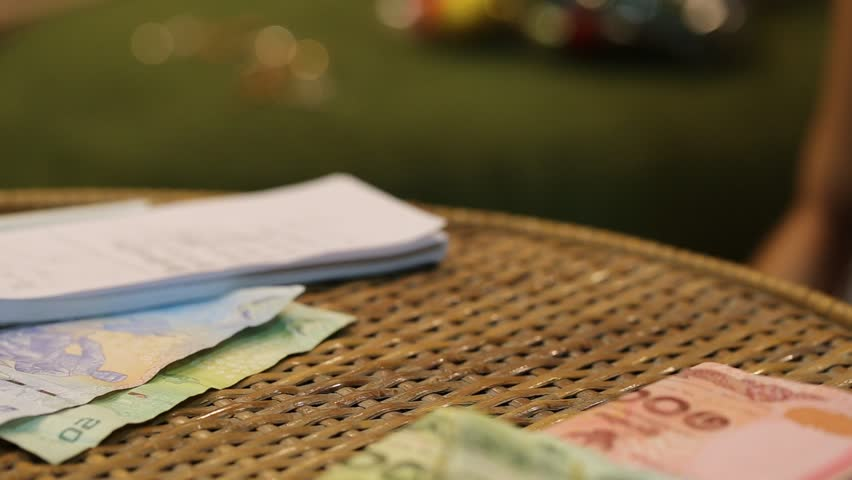 Woman hand counting money closeup on table blur background | Shutterstock HD Video #32856544
