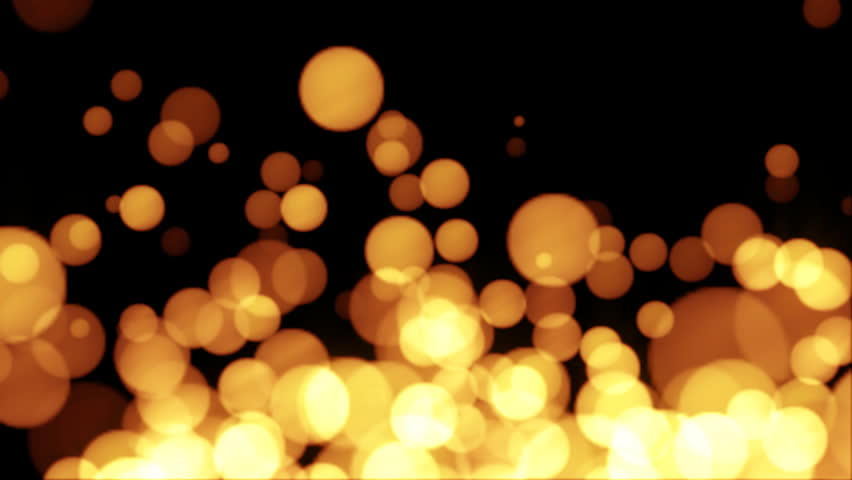 Lens blur of golden moving lights