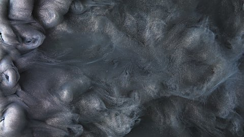 Colorful dark grey paint mixing in water. Ink swirling underwater. Cloud of silky ink. Colored abstract smoke explosion animation. Close up macro view