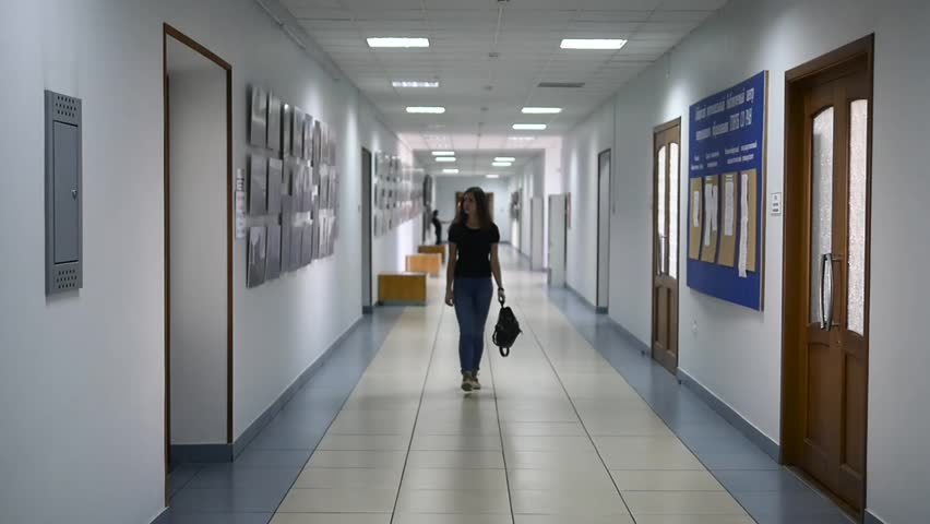 Russia, Novosibirsk, 8 november 2017. A student walking in the corridor of the university | Shutterstock HD Video #32897155