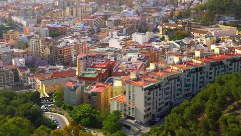 The aerial view of the buildings in Malaga Spain. Malaga is a port city on southern Spains Costa del Sol known for its high-rise hotels and resorts jutting up from yellow-sand beaches.