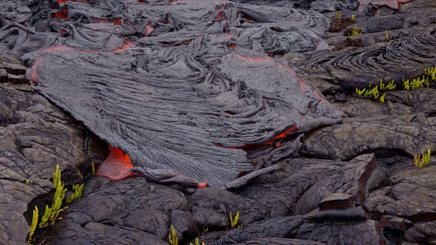 Lava lifts and flows time lapse Day daytime Glowing Hot flow from Kilauea Active Volcano Puu Oo Vent Active Volcano Magma