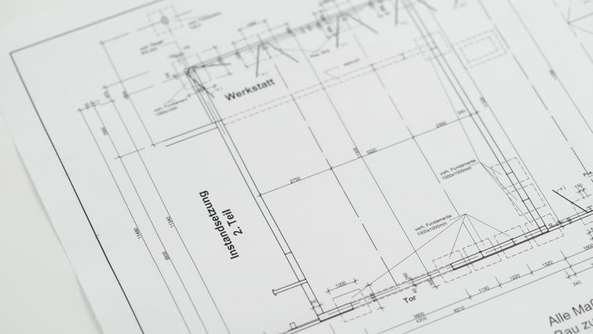 Blueprint of a house looped background full hd ultra hd 4k a hand is putting down two rolled blueprints and a regular compass hd stock footage malvernweather Images