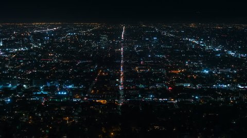 Beautiful view of Los Angeles from Griffith Observatory. Shinning city lights and traffic. California. Timelapse. Zoom in.
