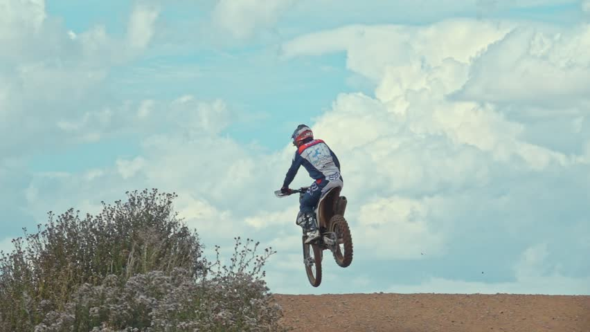 Arnoldsweiler, Germany, July 21,2017:Extreme Motocross MX Rider riding on dirt track on a sunny late summer day. shot on super slow motion camera | Shutterstock HD Video #32981245