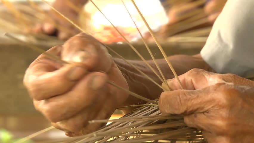 Hand weaving bamboo basket