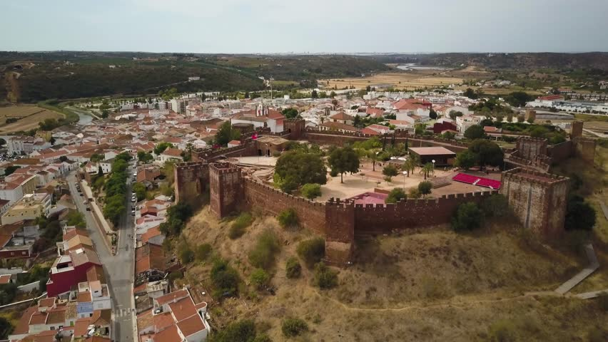 4k drone footage - The ancient medieval castle in Silves, Portugal.  This fortress was built by the Moorish Caliphate when the Moors controlled much of the Iberian peninsula.