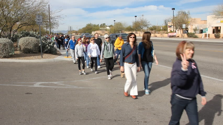 Tucson, AZ - CIRCA 2011: People organize to participate in a walk for peace in honor of Gabriel Giffords.
