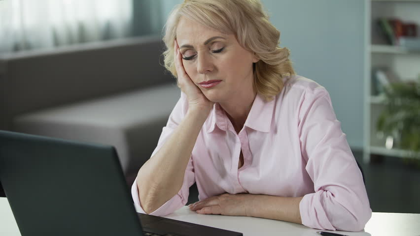 Mature woman falling asleep at workplace, lack of vitamins and energy, tired | Shutterstock HD Video #33021595