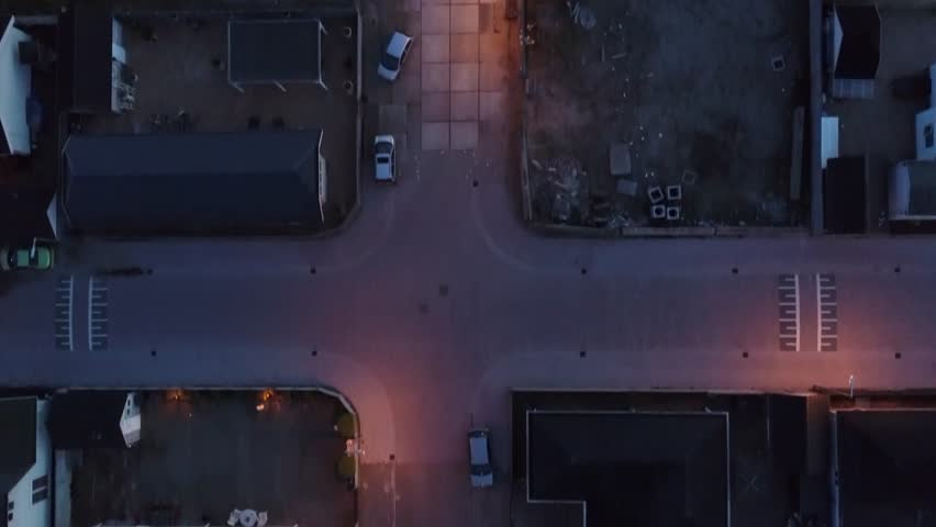 ... Aerial night flight straight top down view over trailer park  semi-permanent or permanent area ...