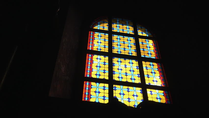 Colorful stained glass window in the dark room