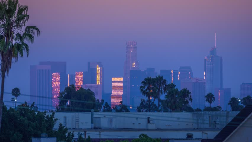 Sunset sun reflecting off skyscraper buildings in downtown of Los Angeles as city skyline changes from sunset to dusk. 4K UHD timelapse. | Shutterstock HD Video #33035602