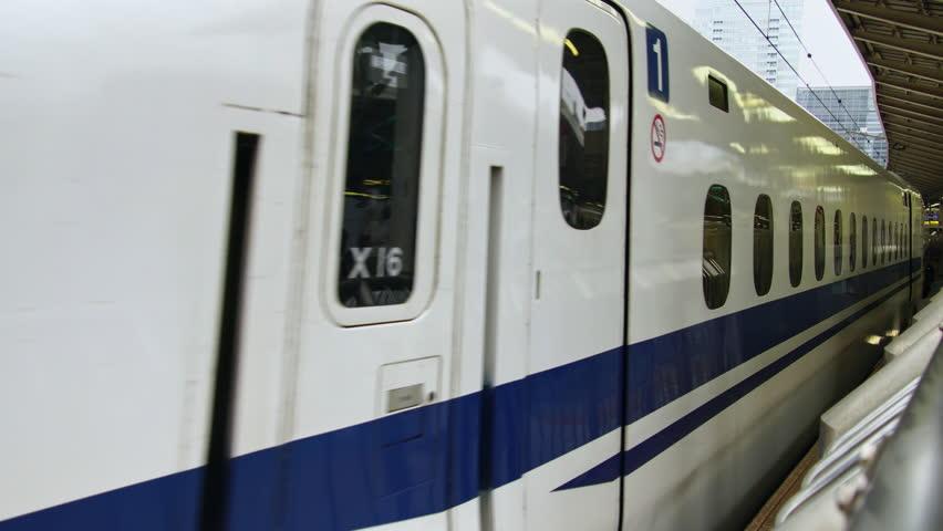 TOKYO, JAPAN - JUNE 2017:  Shinkansen high speed bullet train departing Tokyo city station. Tokyo is a host city of 2020 Olympics | Shutterstock HD Video #33036856